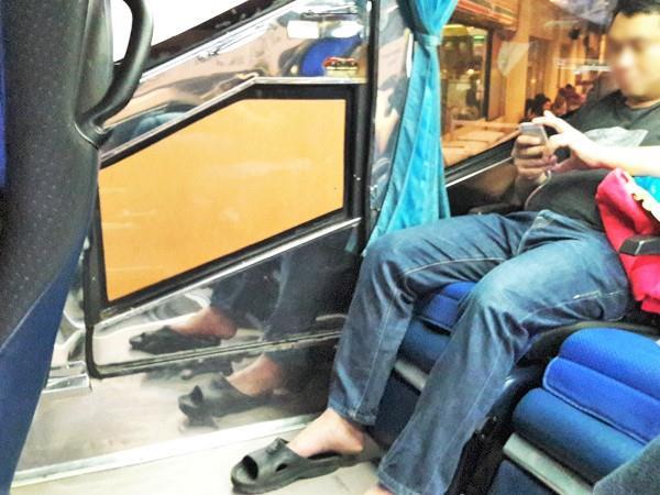 Last row of Sombat Tour bus