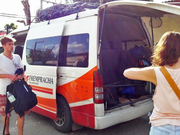 Load luggage into Prempracha Transport minivan
